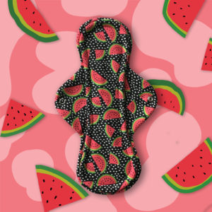 Best overnight cloth pad - primarily black cloth pad patterned with watermelon slices and white polka dots.